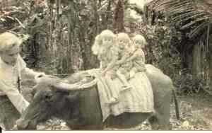 Me leading my sisters on a carabao in Bukidnon in the Philippines