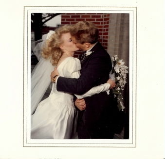 Michelle and I kiss on our wedding day.