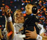 Saints Quarterback Celebrates with his Son After Winning The Super Bowl