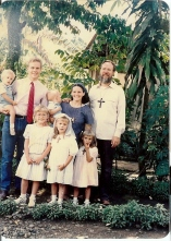 Our family posing in our home garden in the Philippines