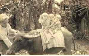 Leading my sisters on a carabao in the Philippines.