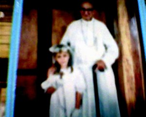 faded image of my sister's First Communion in the Philippines.