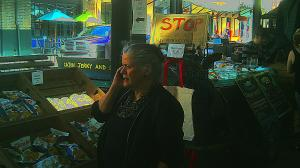 Mom shops and talks on the phone at  the New Orleans French Market.