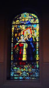 Window in St .Louis Cathedral showing the Crusader saint's body being borne back when he died after launching a great war against Islamists who were terrorizing local Christians and others.