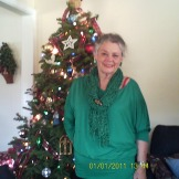 Mom with a Christmas tree in a previous year. Today she is scheduled to buy a tree.