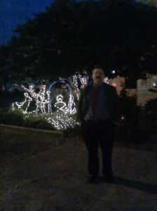 Me in front of a Christmas lights nativity scene shot by one of the proprietors on my phone as I walked into the Donors Dinner.